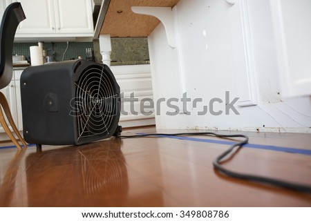 Industrial Fan for Water Damage in Kitchen - stock photo