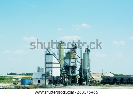 Industrial field with constructions and objects for making cement.