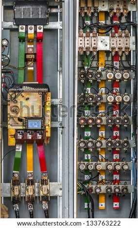 Industrial fuse box on the wall closeup photo - stock photo