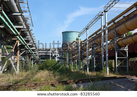 Industrial gas and oil pipelines on metal in a metallurgical plant.