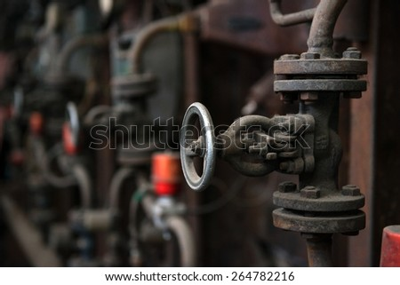 Industrial gate valves closeup photo in the factory - stock photo