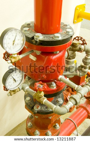 Industrial high pressure valve and taps for a fire extinguishing system. Pressure gauges are showing water pressure. - stock photo