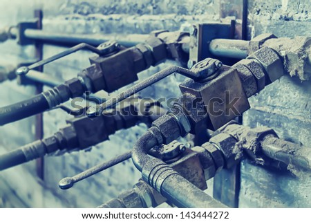 Industrial hydraulic pipe system with valves - stock photo
