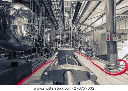 Industrial interior of an alcohol factory with silos - stock photo