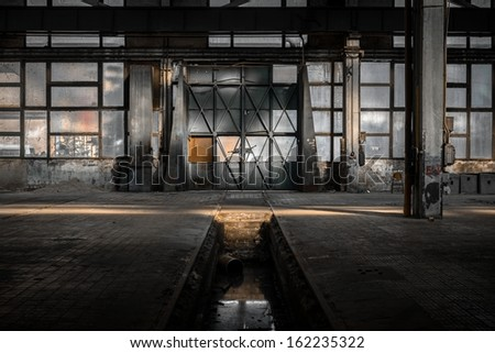 Industrial interior of an old factory - stock photo