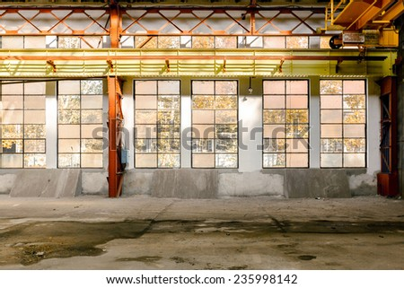 Industrial interior with bright light from the windows - stock photo