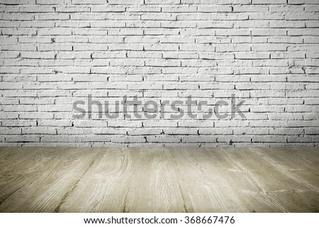 Industrial interior with wooden floor and brick white wall