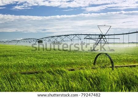 Industrial irrigation equipment on farm field in Saskatchewan, Canada - stock photo