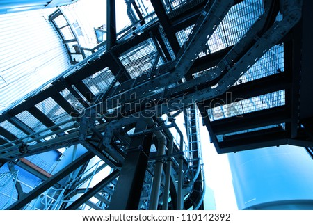 industrial ladders, cables, pipelines in blue tones