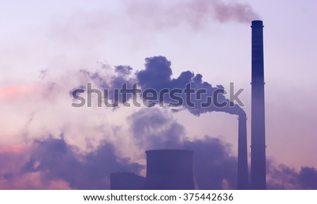 Industrial landscape at dawn. Smoking industrial chimneys at dawn. Concept for environmental protection