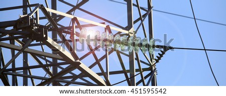 industrial landscape, high-voltage line on the sky background in summer sunny day
