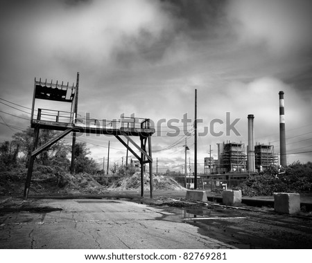 Industrial landscape of abandoned smoke stacks and waste removal plant - stock photo