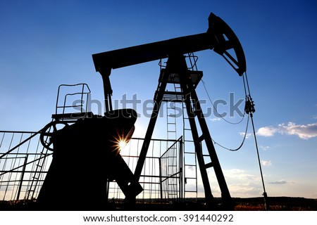 industrial landscape oil pumps in a field on a summer day - stock photo