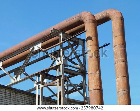 Industrial landscape, the heat pipes. - stock photo