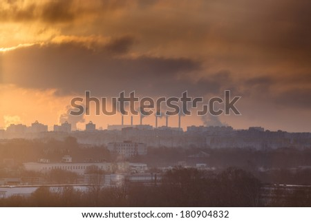 Industrial landscape with a thermal power plant and clouds at sunrise - stock photo