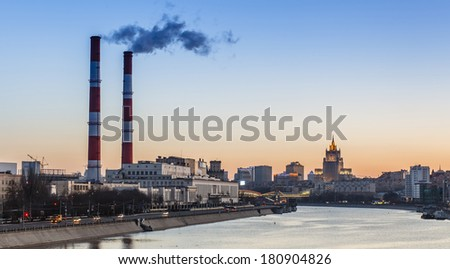 Industrial landscape with a thermal power plant in the city at sunrise - stock photo