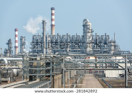 Industrial landscape with chimneys tank - stock photo