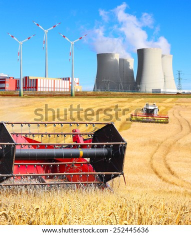 Industrial landscape with different energy resources. Biomass, wind power and atomic energy. - stock photo