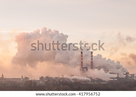 Industrial landscape with pipes and smoke from big plant - stock photo