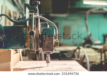 industrial lathe tool, drilling and milling tool, iron drill in action at steel and metal factory. vintage effect - stock photo