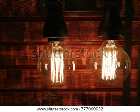 industrial looking light bulb on a wood background