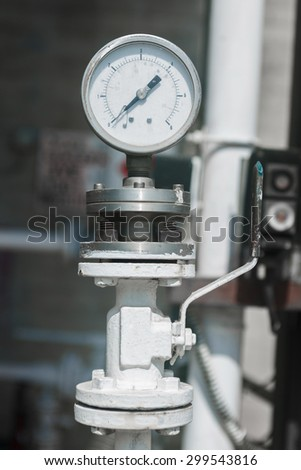 Industrial manometer on chemical plant - stock photo