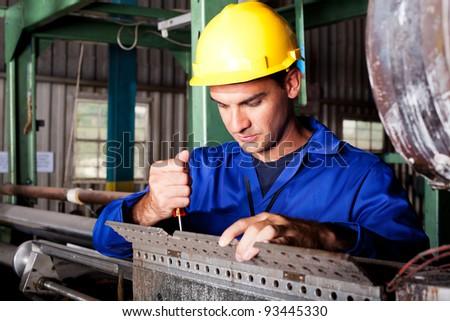 industrial mechanic repairing heavy industry machine - stock photo