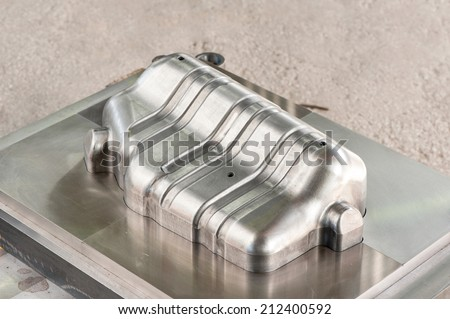 Industrial metal matrix mold/punch. Lathe milling and drilling industry. Mechanical engineering and metalworking. CNC technology. - stock photo