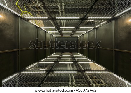 Industrial metal mesh room - stock photo