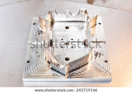 Industrial metal mold blank. Metalworking. CNC milling technology. Mechanical engineering. Indoors closeup. - stock photo