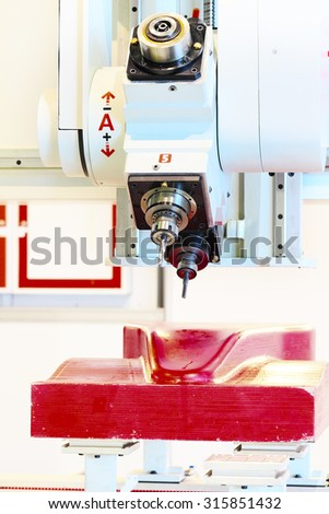 Industrial milling CNC machine tool with replaceable end mills - stock photo