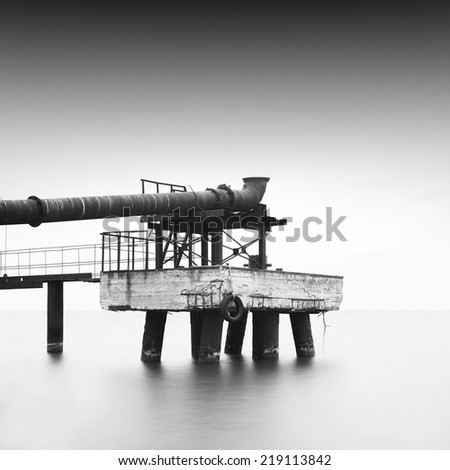 Industrial object on the sea. Black and white daytime long exposure shot. Odessa, Ukraine - stock photo