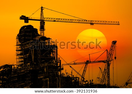 Industrial Oil refinery in building on sunset background at industrial plants.