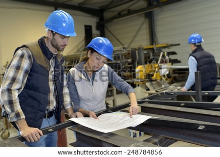 Industrial people meeting together in factory - stock photo