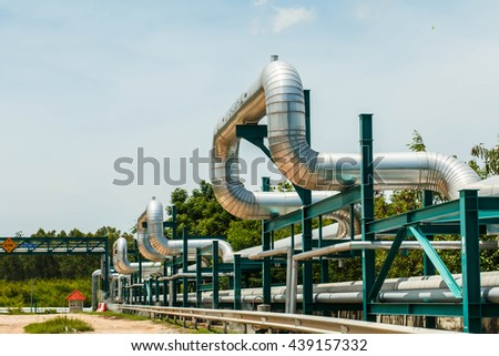 industrial pipelines on pipe-bridge  - stock photo