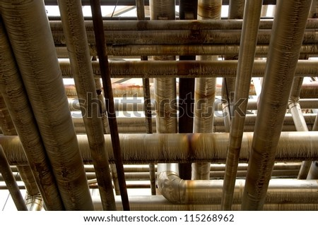Industrial pipes flowing in various directions at an oil and gas refinery