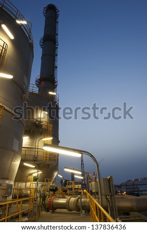 Industrial plant at night - stock photo