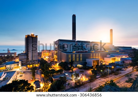 Industrial plant in Hong Kong during sunset - stock photo