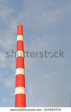 Industrial plant smoke stack and sky. - stock photo