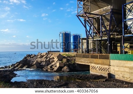Industrial plant, Water pollution on sea  - stock photo