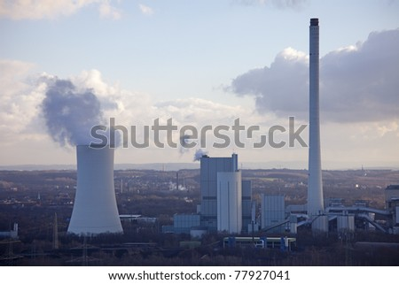 Industrial Plant with smoking Cooling Tower - Recklinghausen, North Rhine-Westphalia, Germany - stock photo