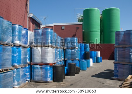 Industrial plastic drums used to ship fertilizers and chemicals - stock photo