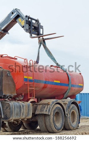 Industrial platform. Truck lifting by means of a loader. - stock photo