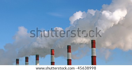Industrial pollution against the blue sky