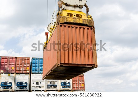 Industrial port crane loading import and export Containers box in a Cargo container ship.