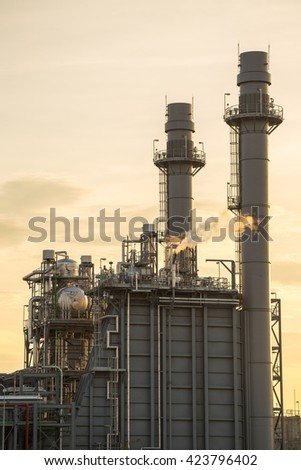 Industrial power plant at sunset. - stock photo