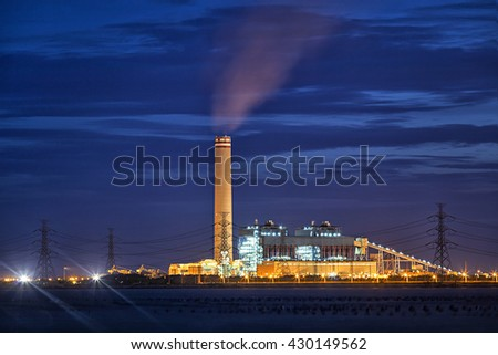 Industrial power plant with smoke stack - stock photo