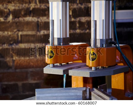Industrial press with danger sign close up - stock photo