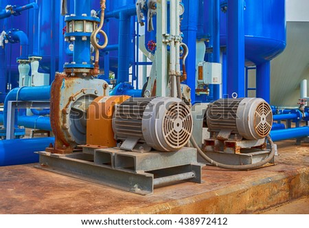 industrial pumps and pipes - stock photo