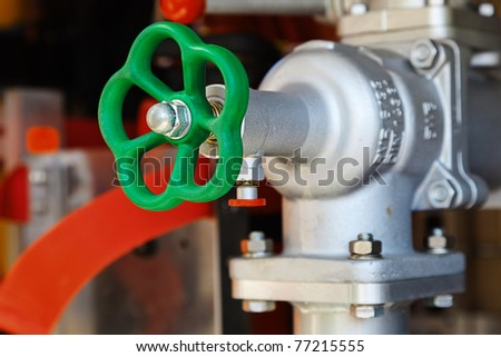 Industrial red stop faucet construction - stock photo
